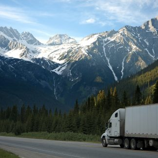 Lone tractor-trailer, mountaines